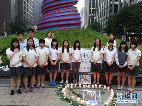 韓國中學生舉行活動哀悼韓亞空難中國遇難者